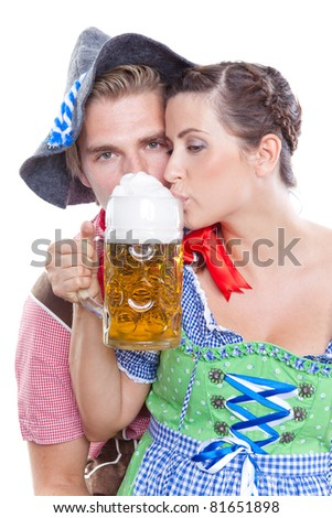 traditional couple drinking a beer together - stock photo