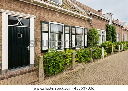 Traditional cozy houses in the Netherlands - stock photo