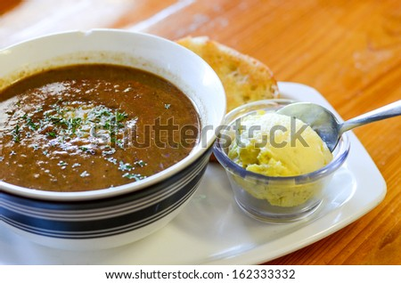 Traditional creole cajun gumbo with potato salad - stock photo