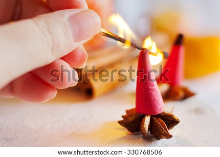traditional Czech Christmas - smoking incense cones, star anise and cinnamon - stock photo