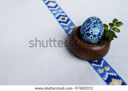 Traditional czech painted egg on vintage table cloath - stock photo