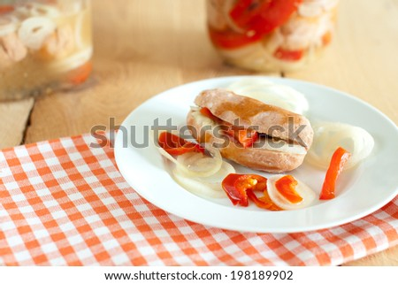 traditional czech pickled sausages with onion and red pepper - stock photo