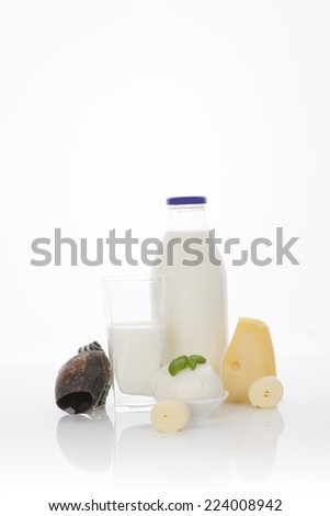 Traditional dairy products. Milk glass bottle, cheese, cottage cheese and curd isolated on white background. Healthy eating.