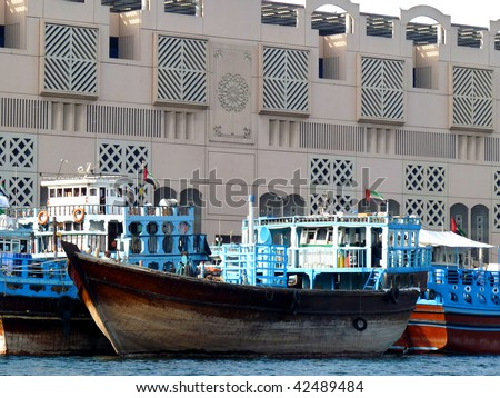 Traditional Dhow (Boats) used for Transporting Trade in Dubai Creek. - stock photo