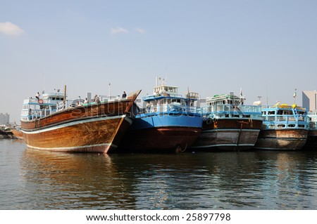 Traditional Dhows at Dubai Creek, United Arab Emirates - stock photo