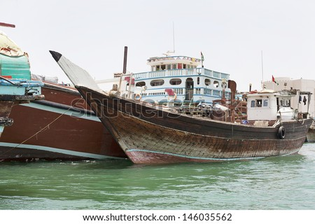 Traditional Dhows, cargo carrying boats, moored at Dubai Creek, United Arab Emirates - stock photo
