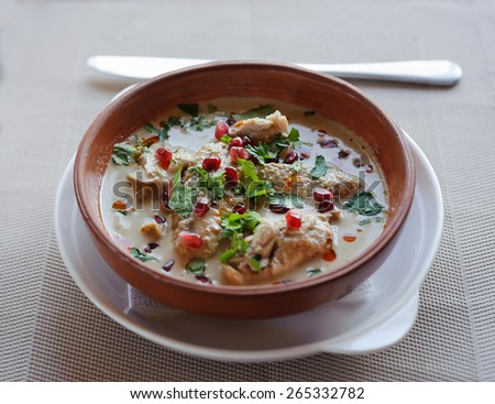 traditional dish of georgian cuisine cooked with chicken in wooden bowl - stock photo
