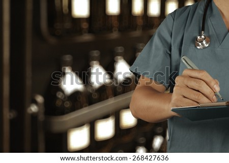 Traditional doctor working with blurred vintage bottle with bokeh background as vintage old school concept