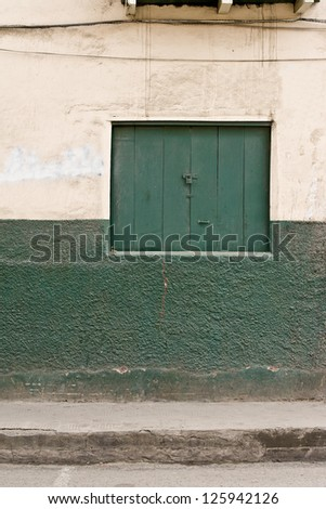 Traditional Door in Old Colonial wall,green window - stock photo