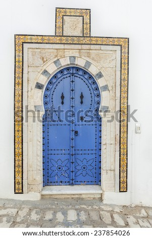 Traditional door with pattern and tiles from Sidi Bou Said, Tunisia - stock photo