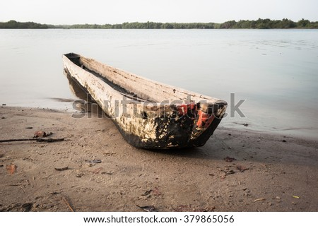 Traditional dugout wooden canoe on the Mono's river shore, Benin, Africa, 2015 - stock photo