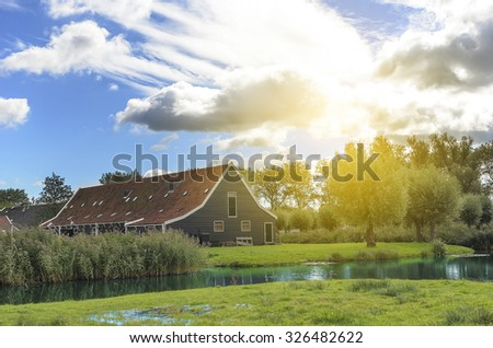 Traditional Dutch a farm on the banks of the canal. - stock photo