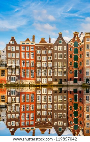 Traditional dutch buildings on canal in Amsterdam - stock photo
