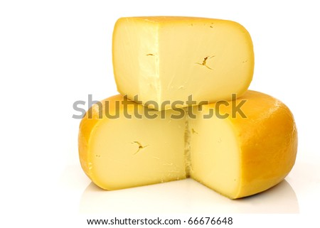 traditional Dutch Gouda cheese with a piece on top on a white background