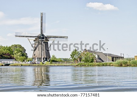 Traditional dutch windmill in the countryside from the Netherlands