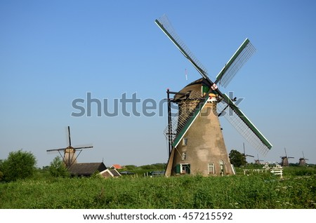 Traditional dutch windmills in the famous place of Kinderdijk, UNESCO world heritage site. Netherlands, Europe.