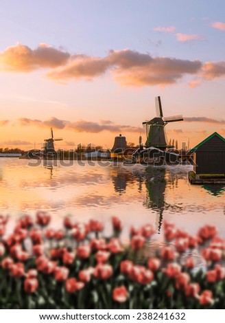 Traditional Dutch windmills  in  Zaanse Schans, Amsterdam area, Holland - stock photo