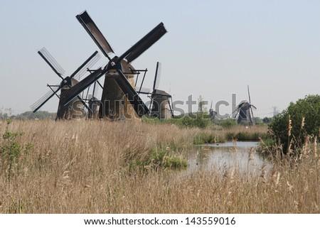 Traditional Dutch windmills near Kinderdijk, The Netherlands - stock photo