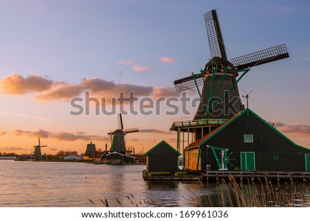 Traditional Dutch windmills with canal in Zaanse Schans near the Amsterdam, Holland - stock photo