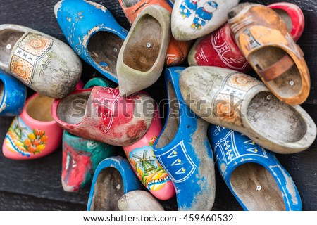 Traditional dutch wooden shoes hanging at a wall. Background