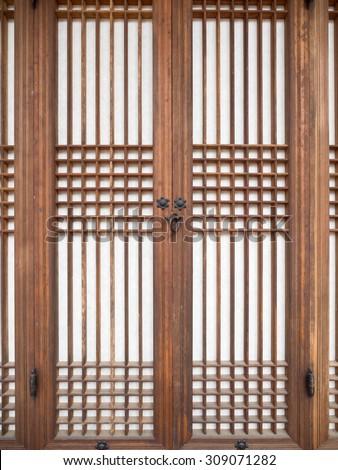 Traditional east asian wooden door. - stock photo