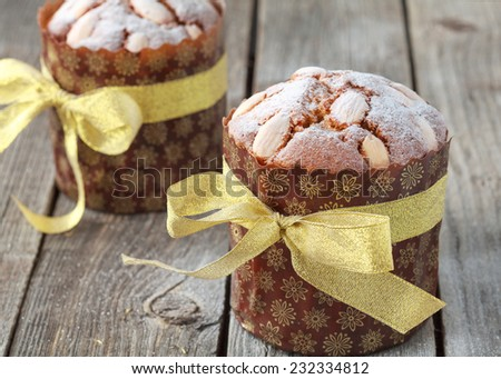 Traditional easter cake or panettone with almonds on the wooden table in rustic style, selective focus on the cake - stock photo