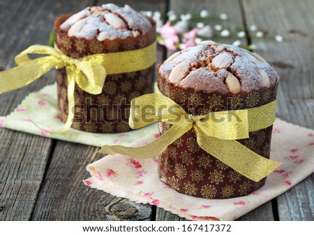 Traditional easter cake with Quail Eggs on the wooden table in rustic style, selective focus on the cake - stock photo