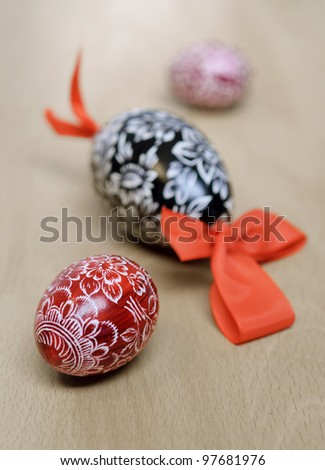 Traditional easter eggs on wooden table - stock photo