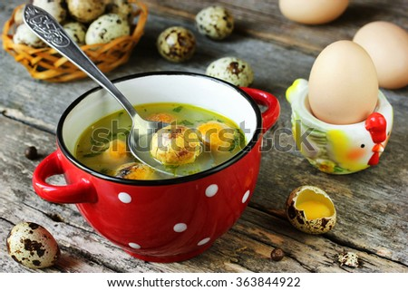 Traditional Easter soup with egg yolks, selective focus - stock photo