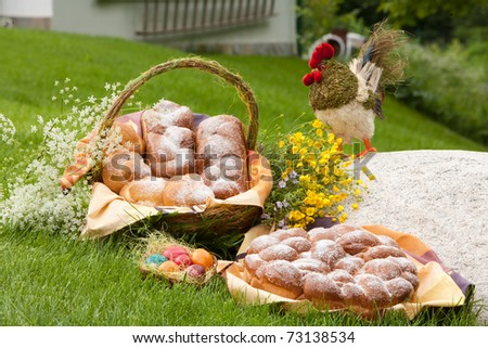 Traditional Easter sweet bread and painted eggs - stock photo