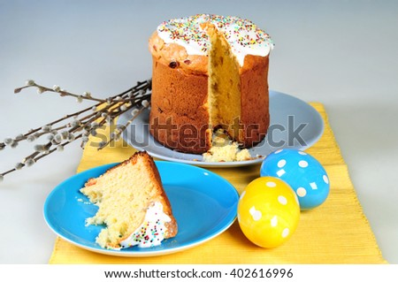 Traditional easter yeast cake covered with white icing and raisins Spongy yeast cake that is traditionally baked for Easter Sunday in Poland, Belarus, Ukraine , Russia. shallow depth of field - stock photo