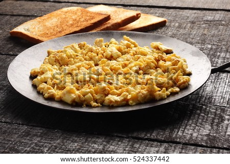 Traditional egg scrambled with bread toast.