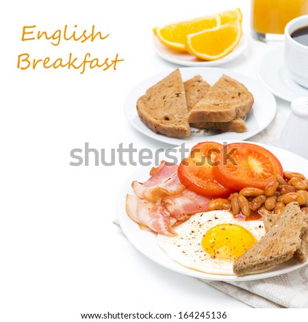 Traditional English breakfast with fried eggs, bacon and beans, isolated on white - stock photo