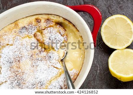 Traditional English lemon pudding, in baking dish. - stock photo