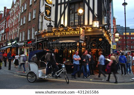 Traditional English Pub The Three Greyhounds in London SOHO district LONDON, ENGLAND - AUGUST 30, 2014