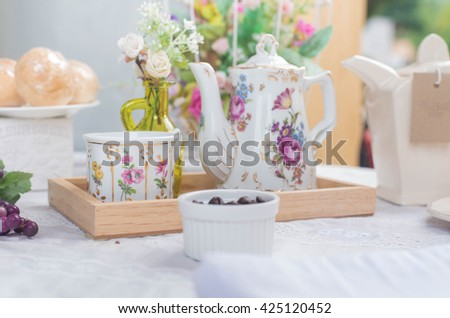 Traditional english tea with floral dishware and rose.Selective focus.Tea composition, tea set - stock photo