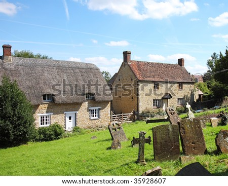 Traditional English Village Cottages viewed from the Churchyard
