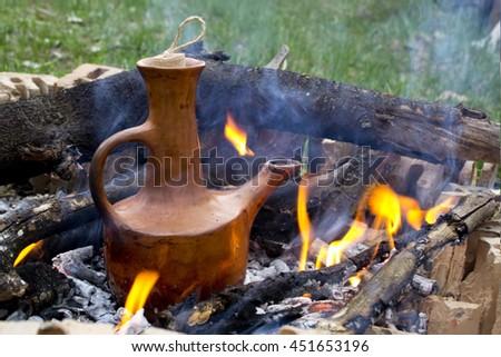 Traditional Ethiopian coffee in jebena - stock photo