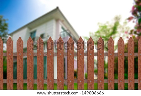 traditional fence with home & garden background, included clipping path - stock photo