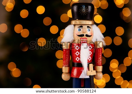 Traditional Figurine Christmas Nutcracker Wearing A Old Military Style Uniform - stock photo