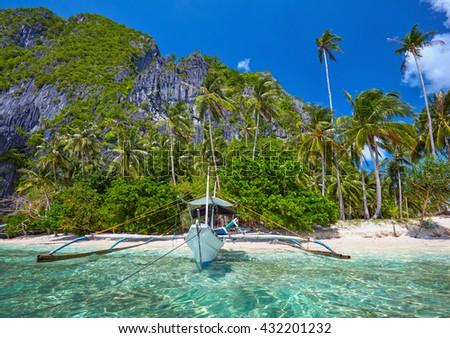 Traditional filippino boat at El Nido bay. Palawan island, Philippines - stock photo