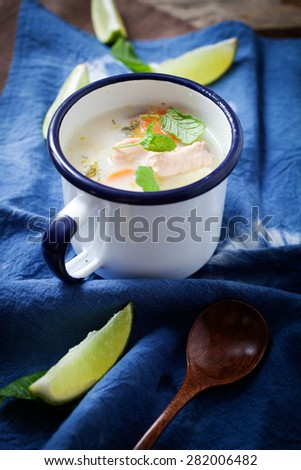 Traditional finnish salmon soup in mug - stock photo