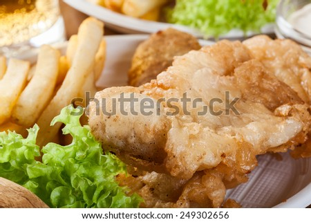 Traditional fish and chips with tartar sauce on a tray - stock photo