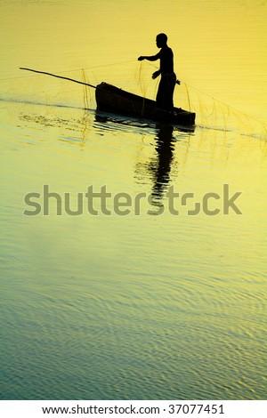 Traditional Fisherman at Sunset - stock photo