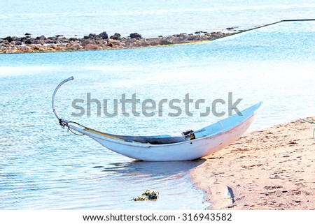 Traditional fishing boat in Portugal - stock photo