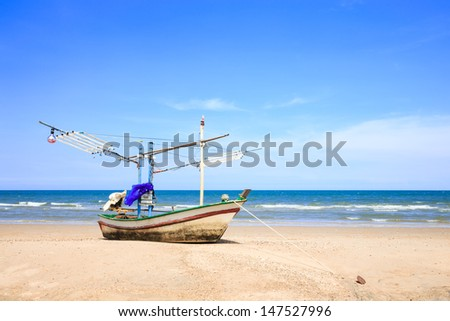 Traditional fishing boat on the beach - stock photo