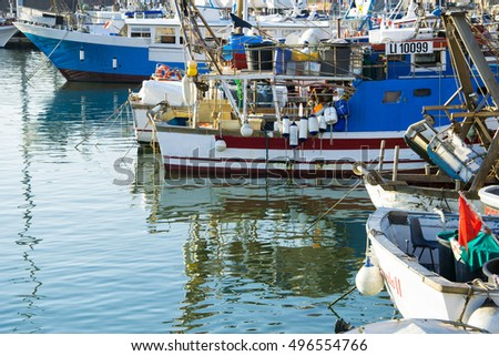 Traditional fishing boats in Livorno port, Tuscany, Italy.