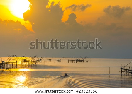 Traditional fishing have man in boat at south of thailand. sunrise background