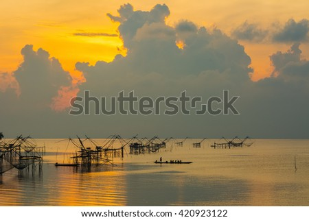 Traditional fishing in south of thailand. sunrise background