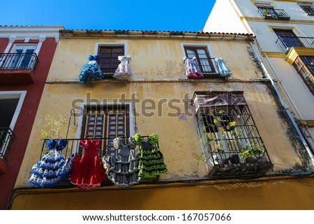 Traditional flamenco dresses at a typical house in Malaga, Andalusia, Spain. - stock photo